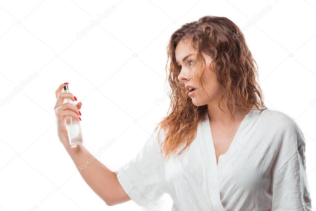 Young woman with hairspray