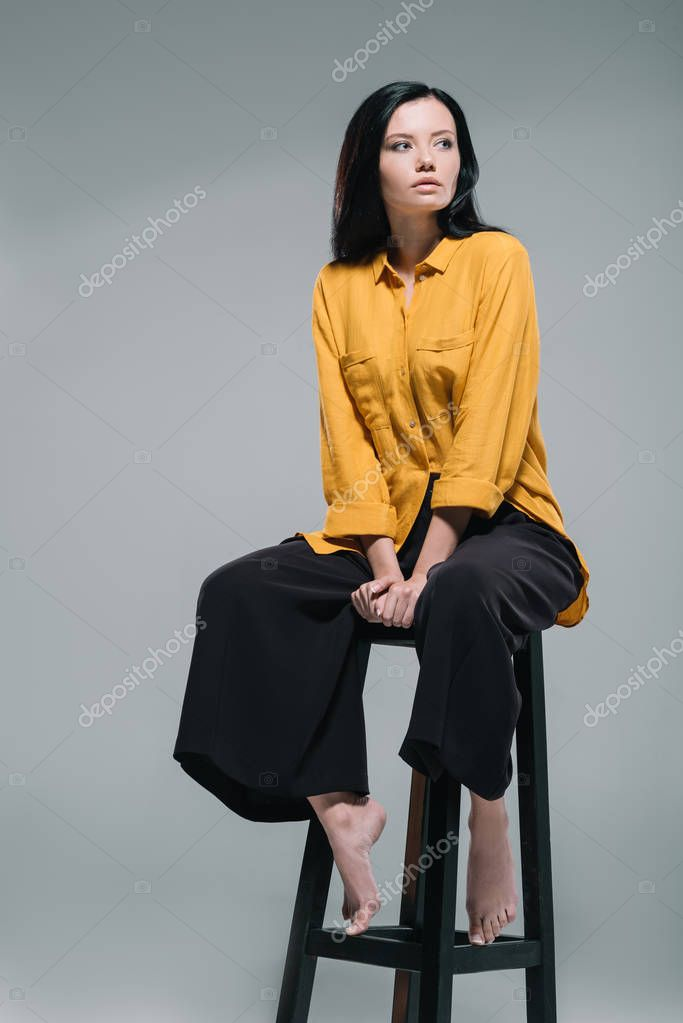 brunette woman in yellow blouse