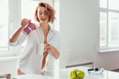 Beautiful cheerful girl pouring coffee from pot on self isolation stock vector