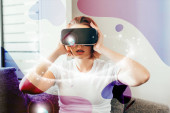 emotional girl using virtual reality headset with glowing signs at home on quarantine