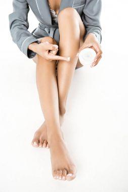 woman applying body cream