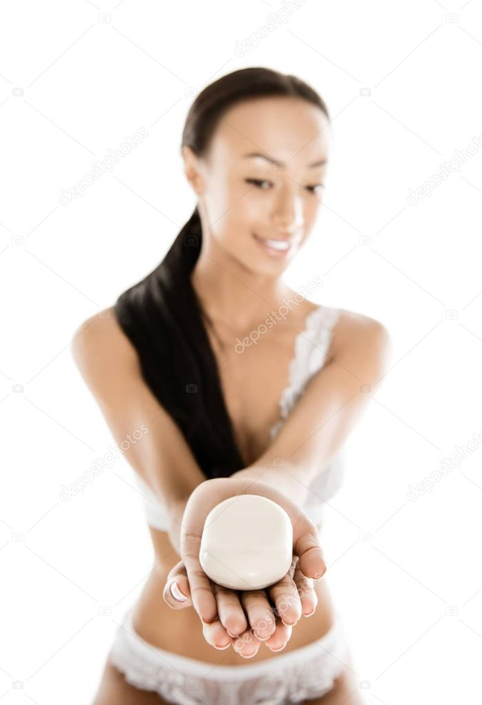 african american woman holding soap
