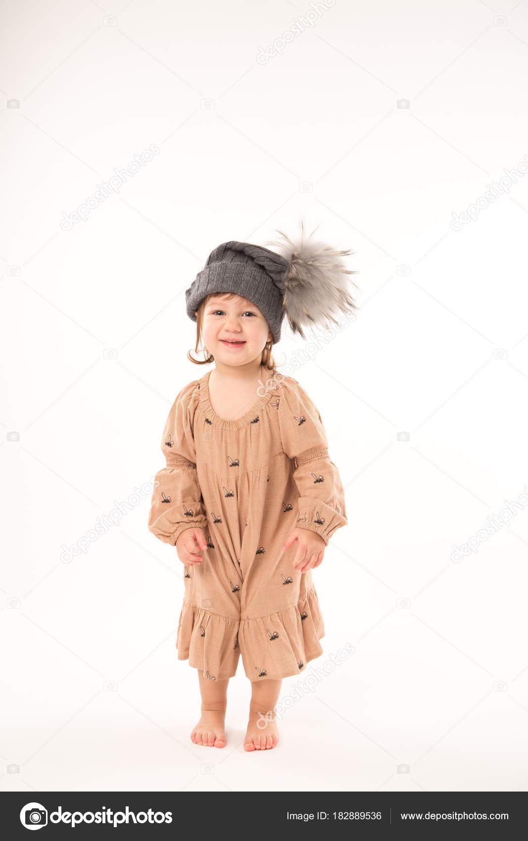 Robe beige petite fille