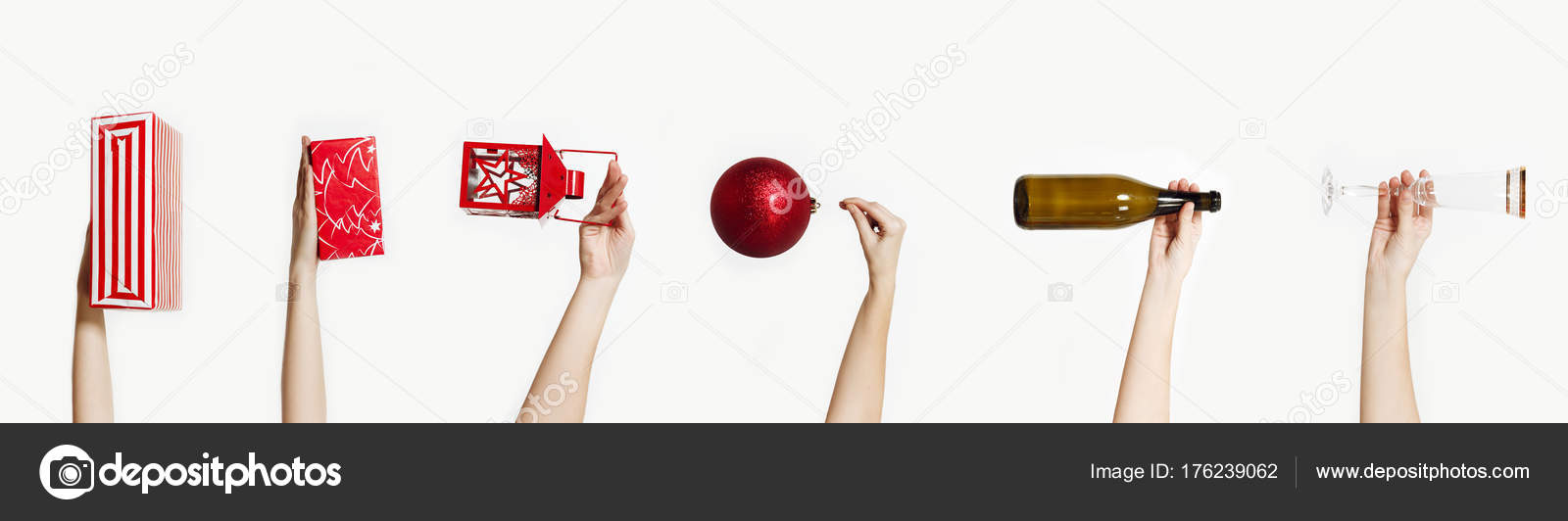 489b95c6a59d Set of hands holding Christmas things isolated on a white background. Wine  glass, champagne bottle, big red toy ball for tree, gift box, lantern with  candle ...
