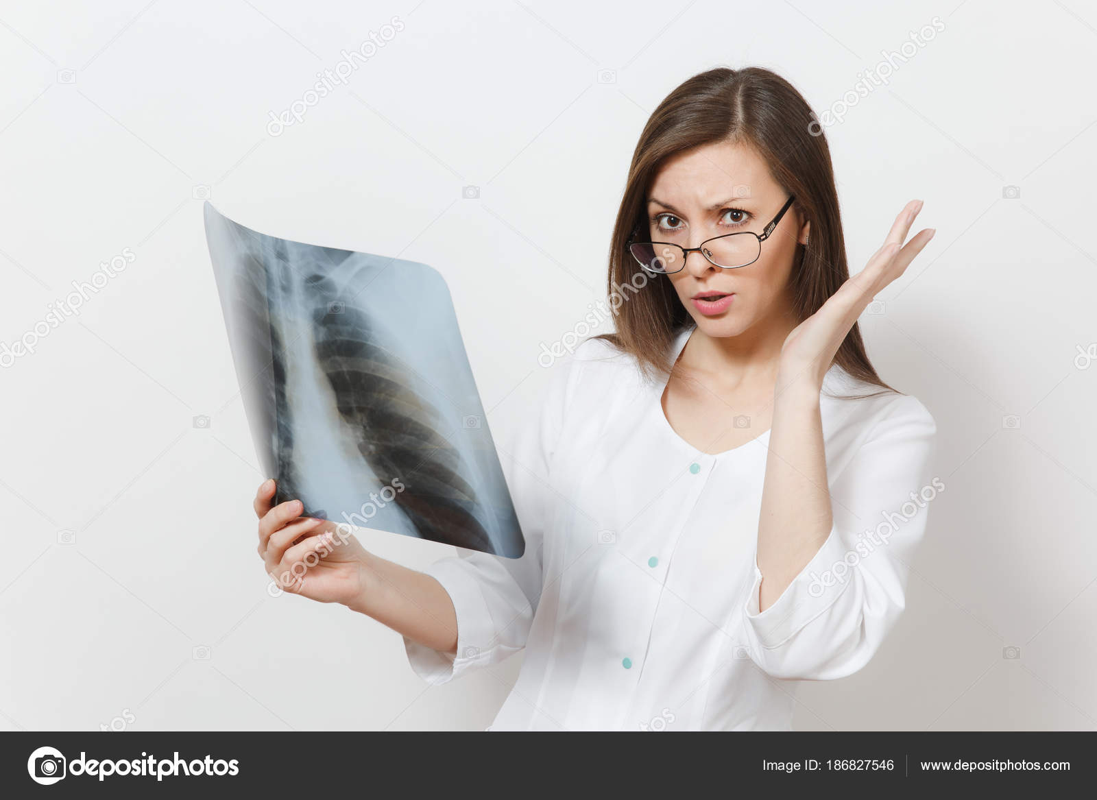 Perplexed focused doctor woman with X-ray of lungs, fluorography ...