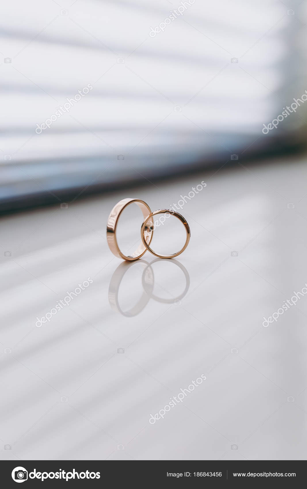 Close up Two beautiful stylish gold wedding rings of the bride and ...