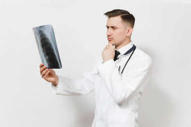 Perplexed focused doctor man with X-ray of lungs, fluorography, roentgen isolated on white background. Male doctor in medical uniform, stethoscope. Healthcare personnel, medicine concept. Pneumonia.