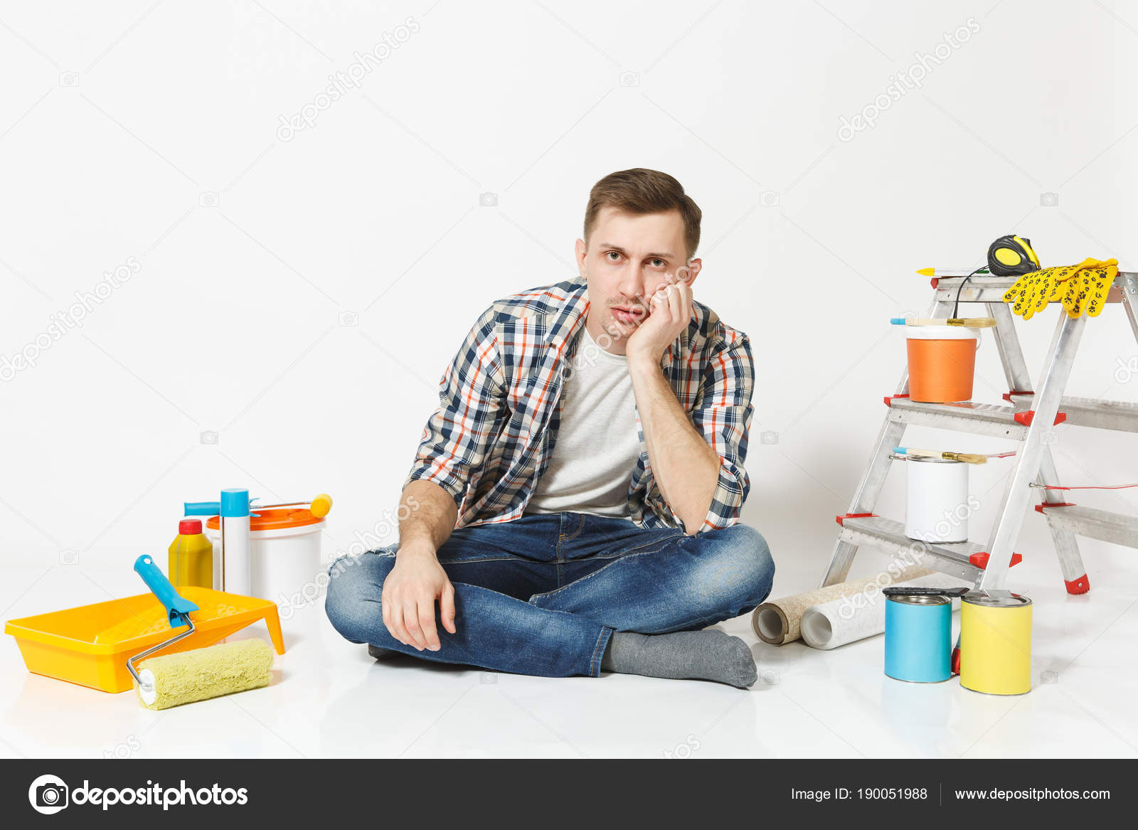 Confused Indifferent Annoyed Man Sitting On Floor With Tired Expression Face Instruments For Renovation Apartment Isolated White Background Wallpaper