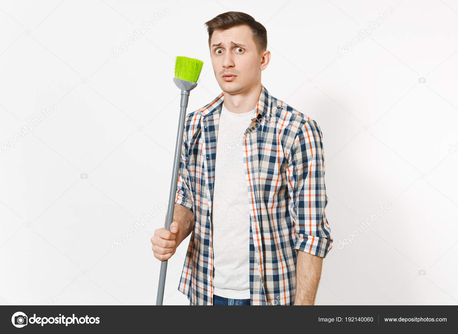 Young Strange Fun Housekeeper Man In Checkered Shirt Holding And