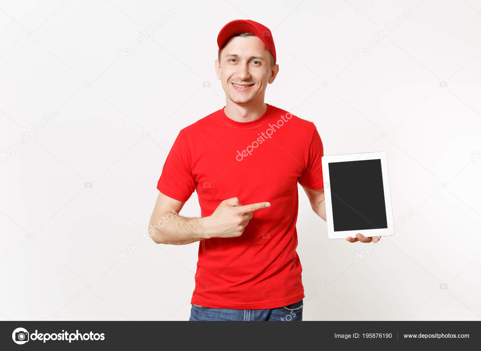 740fafe5 Delivery man in red uniform isolated on white background. Male in cap, t- shirt, jeans working as courier or dealer, holding tablet pc computer with  blank ...