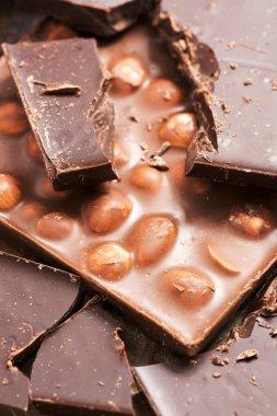 Chocolate with nuts and dark chocolate closeup.