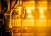 Fotografie Legal law concept image.  Scales of Justice lit golden light