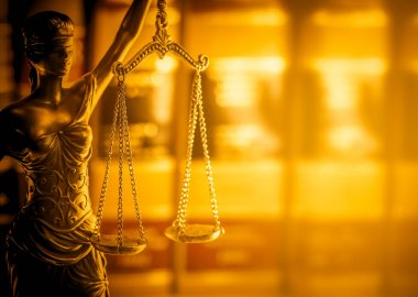 Legal law concept image.  Scales of Justice lit golden light