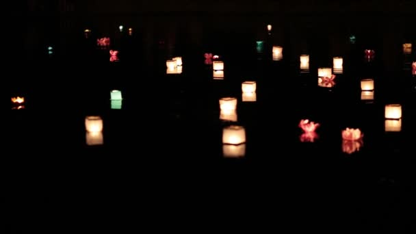 Lanterns floating on the river waters with no people.