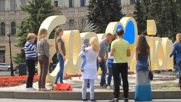 People photographed near the official logo of Eurovision Song Contest
