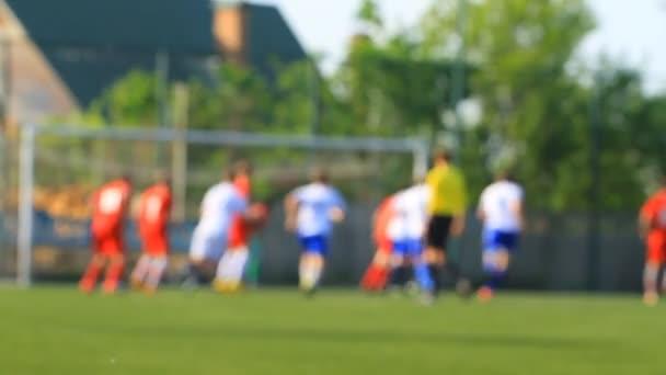 A sarokban a kapunál labdarúgók