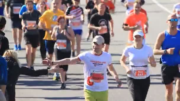 Kyiv, Ukraine - April 22, 2018: People greeting the athletes of runners at the marathon in Kyiv, Ukraine