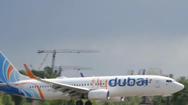 Kyiv, Ukraine - May 18, 2016: Passenger plane is landing the airline Fly Dubai at Zhuliany Airport in Kyiv, Ukraine