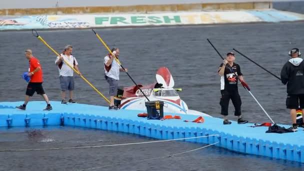 Vyshgorod, Ukraine- July 26, 2013: Grand Prix Formula 1 H2O World Championship Powerboat in Vyshgorod, Ukraine. Bolide Formula 1 H2O in team Qatar preparing for the race.