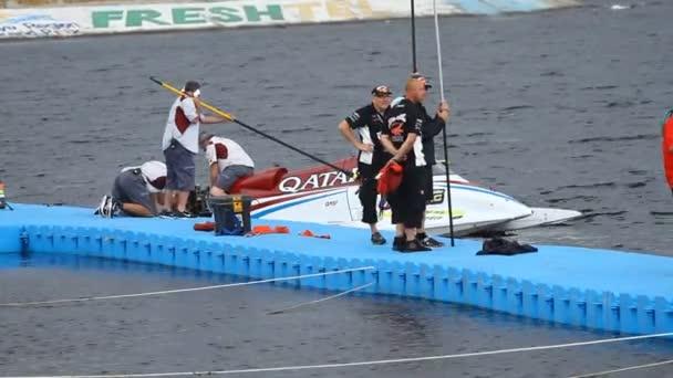 Vyshgorod, Ukraine- July 26, 2013: Grand Prix Formula 1 H2O World Championship Powerboat in Vyshgorod, Ukraine.  Bolide Formula 1 H2O in team Qatar before the race