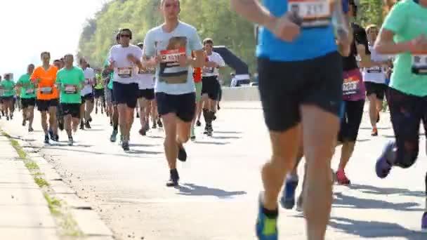 Kyiv, Ukraine - April 26, 2015: Crowd of people running on a city road marathon in Kyiv, Ukraine