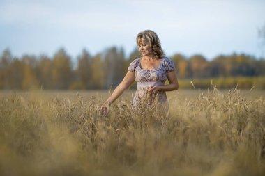 mature woman in wheat field