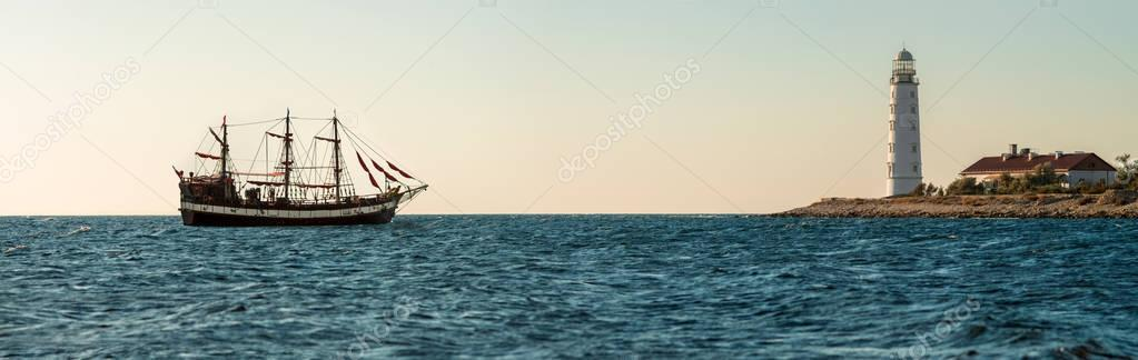 seashore and sailing vessel