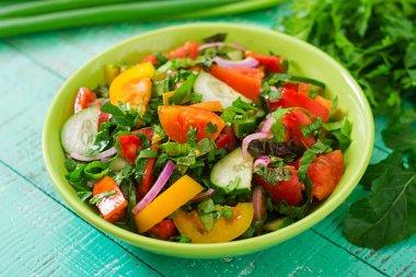 Fresh salad in green bowl