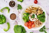 Photo Oatmeal porridge, chicken and vegetables