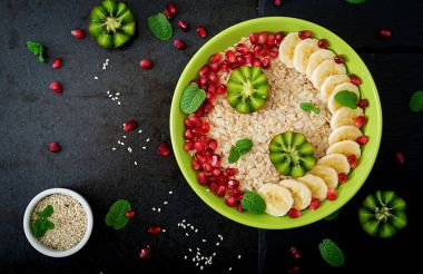 Oatmeal porridge with fruits and seeds