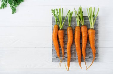 fresh carrots with green leaves
