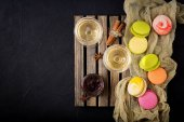 Glasses of white wine and a macarons