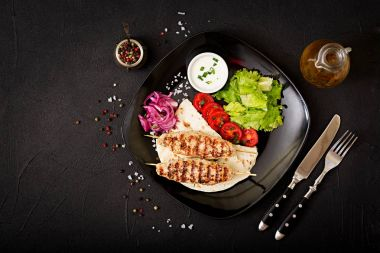 Minced Lula kebab grilled turkey with fresh vegetables on plate