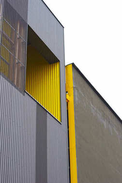 Yellow and grey building front in Nantes