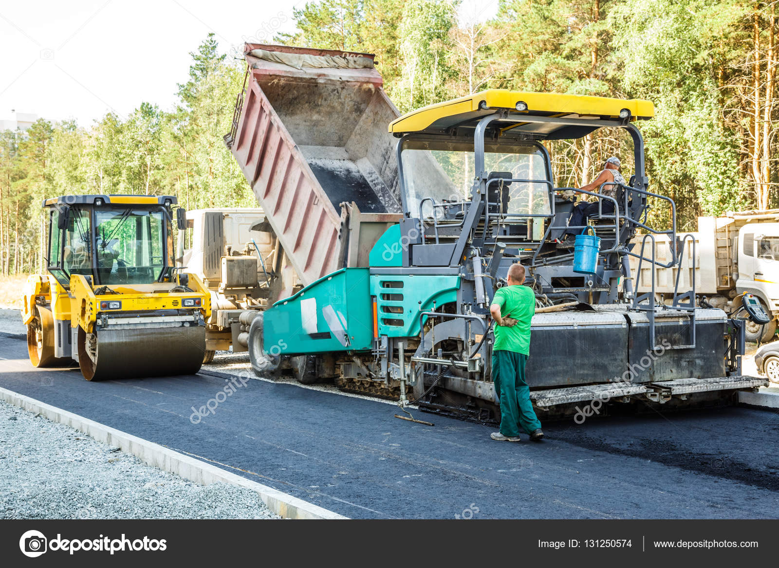 asphalt placing machine working on the city road photo by garsya