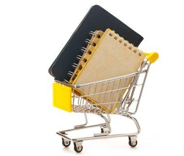Market pushcart with notebooks