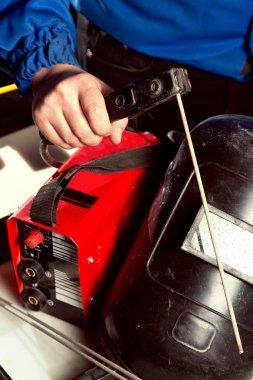 welding unit with helmet shield
