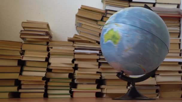 Spinning globe on the background of books