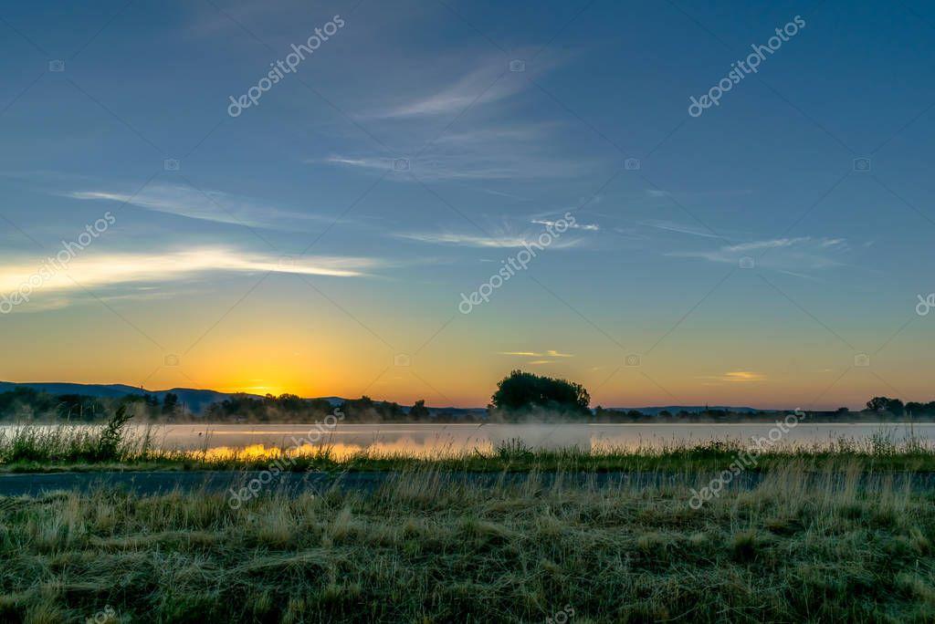 Sunrise at the dam in Male Kozmalovce, Slovakia