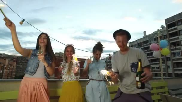 friends dancing with firework candles