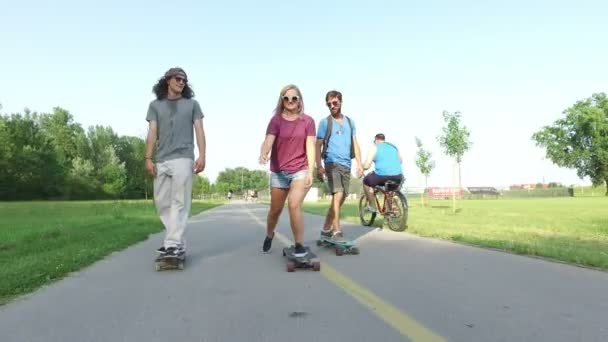 woman longboarding with friends