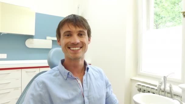 Man with white teeth at dentist