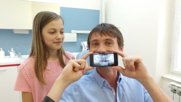 father and daughter playing with X- ray photo
