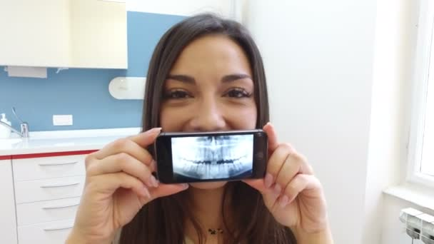 woman holding smartphone with  X- ray