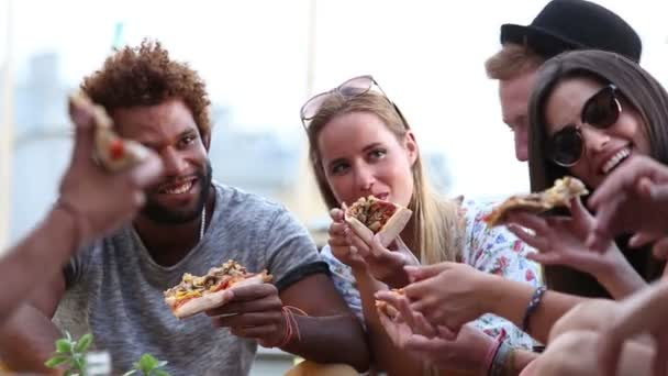 friends at a party eating pizza