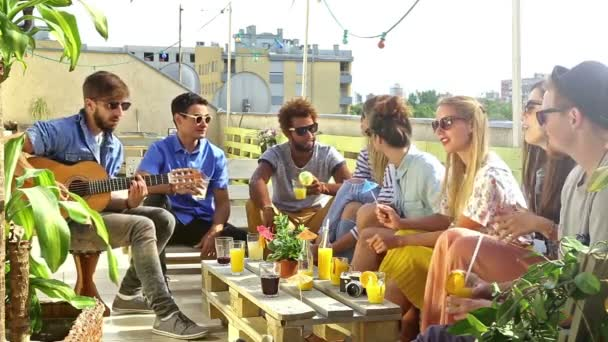 friends on rooftop terrace and talking