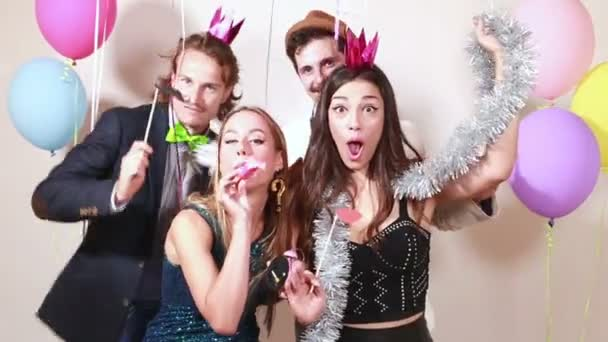 friends having fun in party photo booth