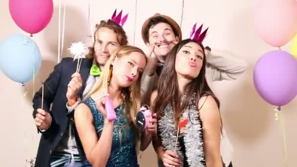 friends in party photo booth