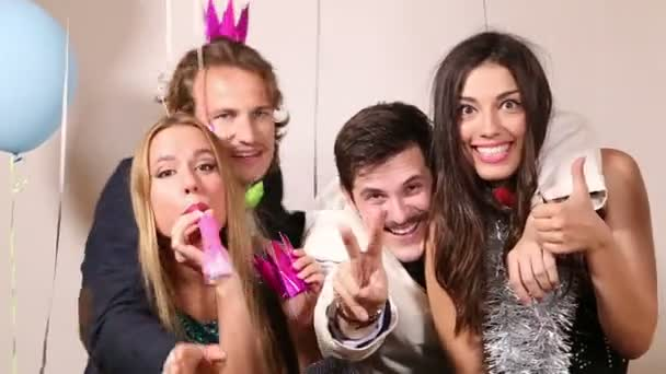 couples having fun in party photo booth