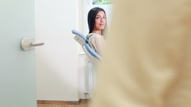 woman sitting in dental chair